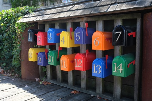 Colorful postboxes for houses right at the marina on water - gotta love them